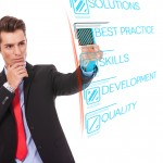 Young business man pushing Best Practice digital button, focus o